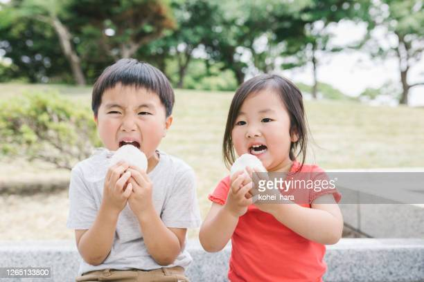 asian brother sister enjoy picnic