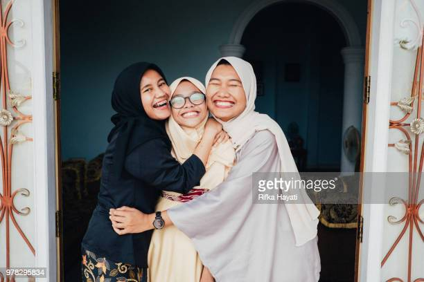 sibling having good time together - eid ul fitr photos stock pictures, royalty-free photos & images