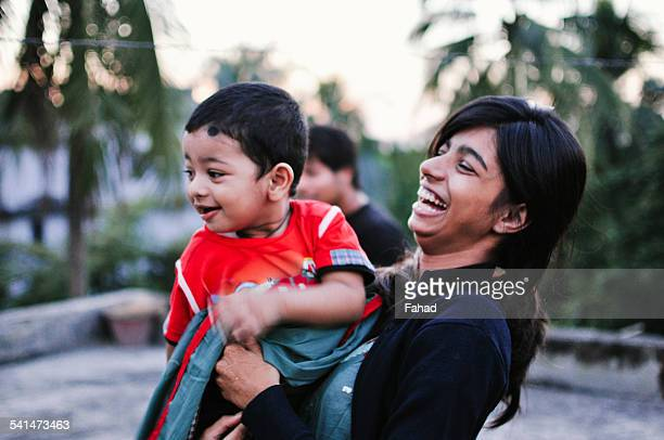 sibling looking at something and laughing - bangladesh stock pictures, royalty-free photos & images