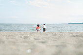 asian brother sister playing beach