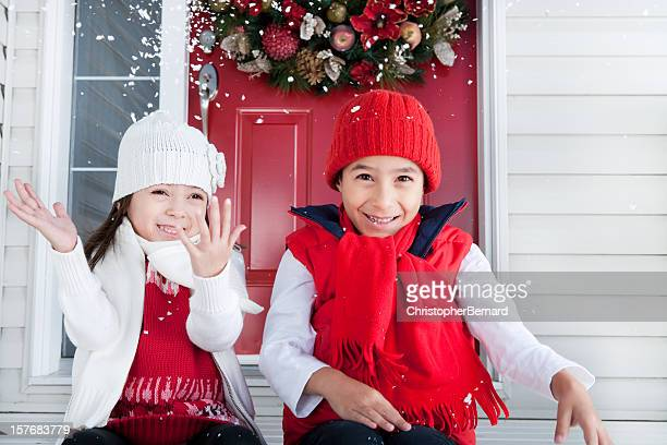 Sibling playing with snow christmas