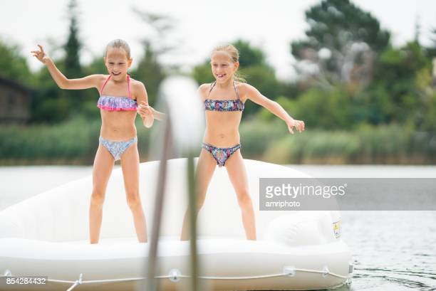 siblings - 9 years old twin girls enjoying summer day on lake - 8 9 years stock pictures, royalty-free photos & images