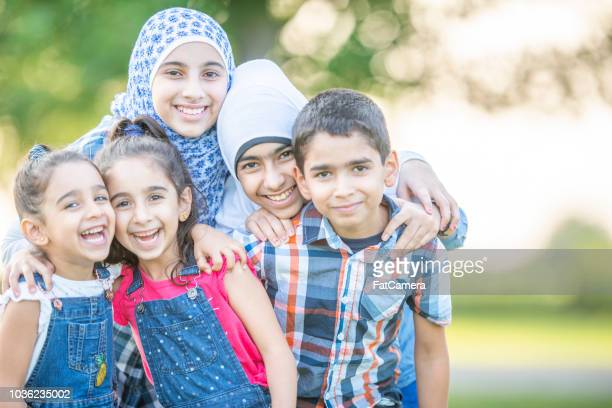 siblings: a large middle eastern family - syrian culture stock photos and pictures