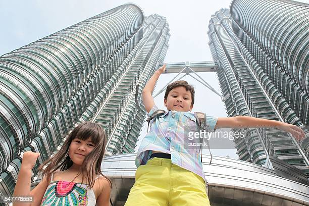 siblings are competing to jump - malaysian culture stock pictures, royalty-free photos & images