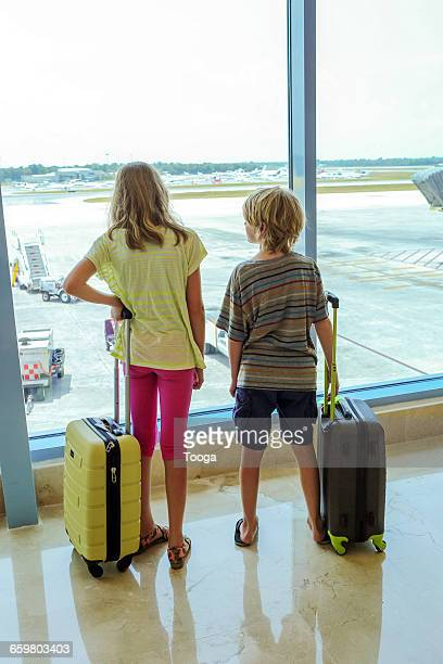 Siblings at airport