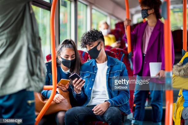 siblings bonding on the bus - bus stock pictures, royalty-free photos & images