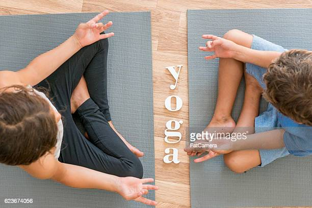 Siblings Doing Yoga Together