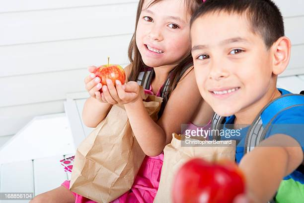 Siblings eating school lunch