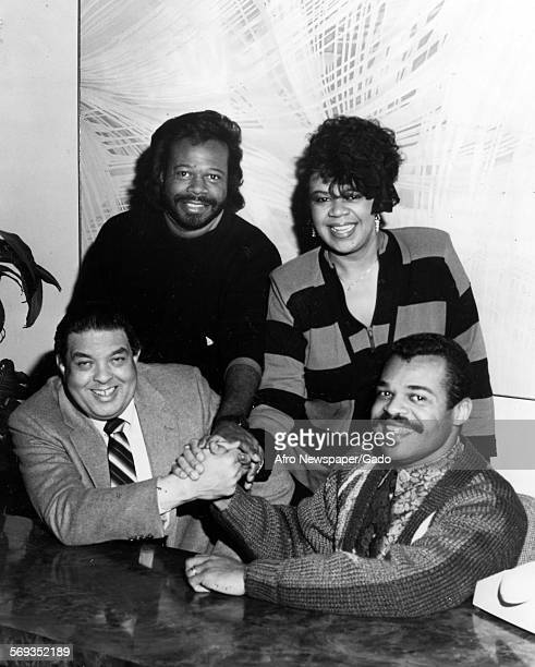 Siblings Edwin Walter and Lynette Hawkins signing with Birthright Records and Dr Byron Spears January 2 1987