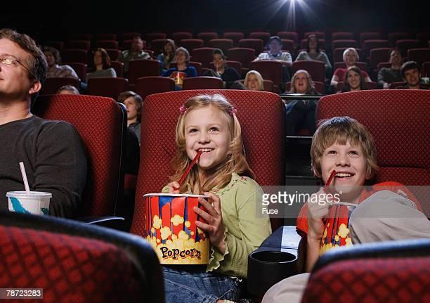 Siblings Enjoying Movie in Theater