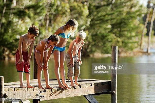 Siblings Examining Lake