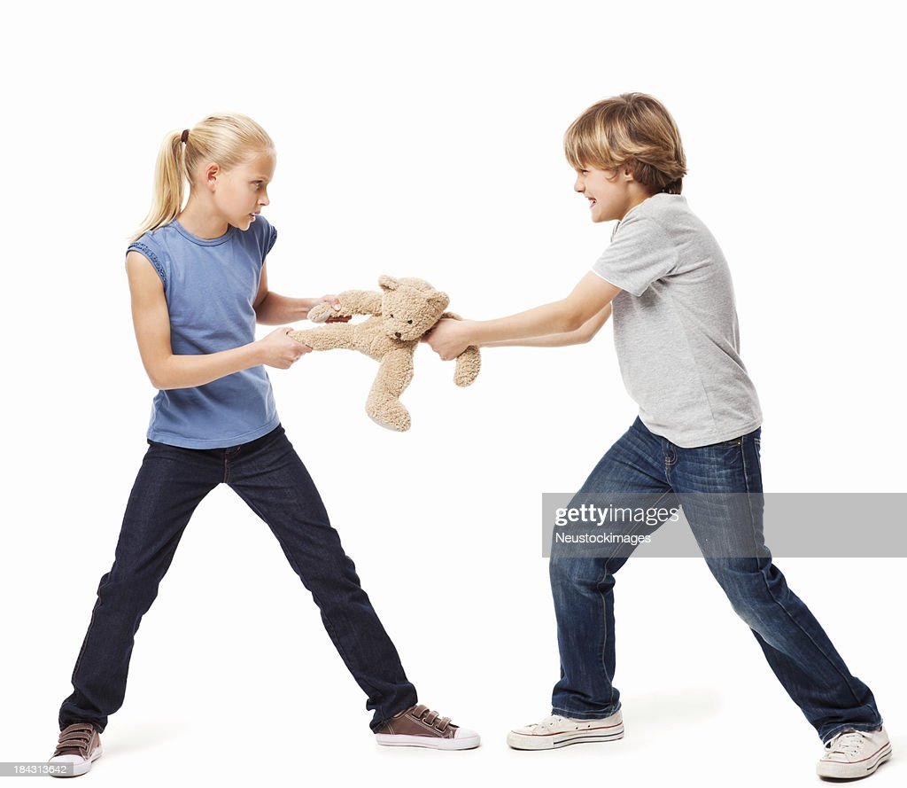 Toys For Siblings : Siblings fighting over a toy isolated stock photo getty