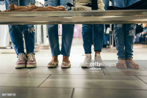 siblings go shoping - girl wear jeans and flip flops stock photos and pictures