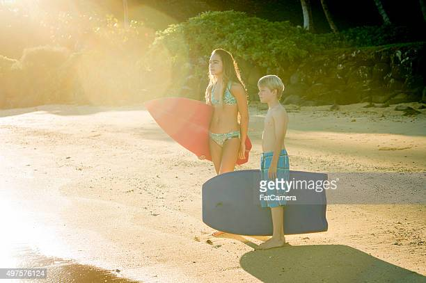 Siblings Going Surfing on Vacation