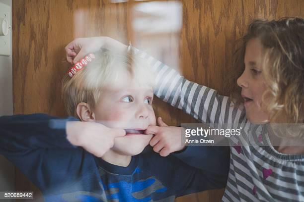 Siblings Goofing Around