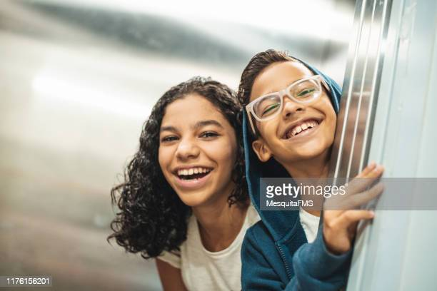 siblings having a funny day - sibling stock pictures, royalty-free photos & images