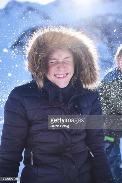 Siblings having snow ball fight, Hintertux, Tirol, Austria