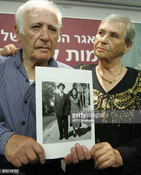 Siblings Hilda Shlick of Ashdod in southern Israel and Simon Glasberg of Ottawa Canada show a photo of their parents Yad Vashem Holocaust Museum...