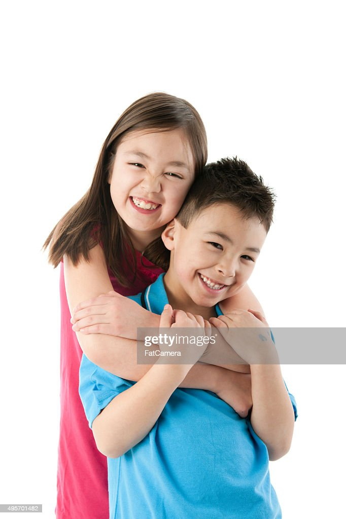 siblings hugging each other stock photo getty images