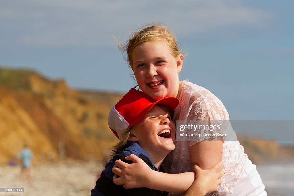Siblings hugging : Stock Photo