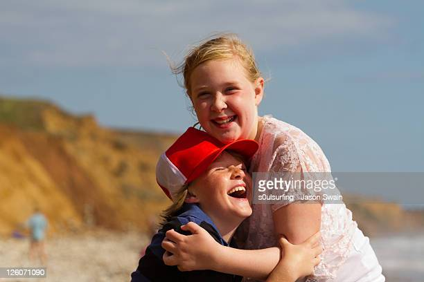 siblings hugging - s0ulsurfing stock pictures, royalty-free photos & images