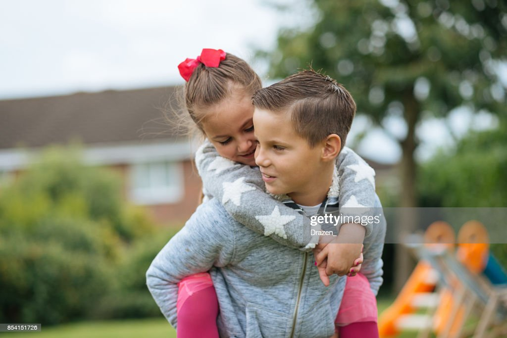 Siblings in England - crazy love for brother or sister : Stock Photo