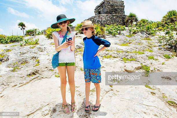 Siblings looking at picture on phone