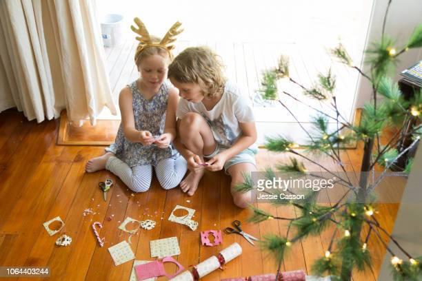 Siblings make Christmas decorations together