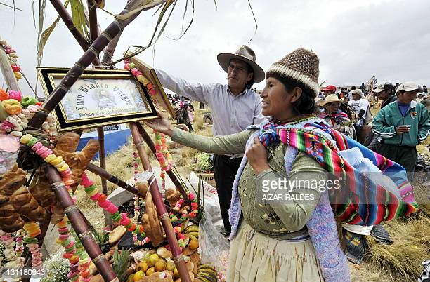 Siblings Mercedes and Fernando Blanco visit the grave of their parents at the Villa Ingenio cemetery in El Alto 25 Km west of La Paz on November 2...