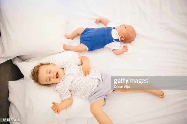 Siblings on bed