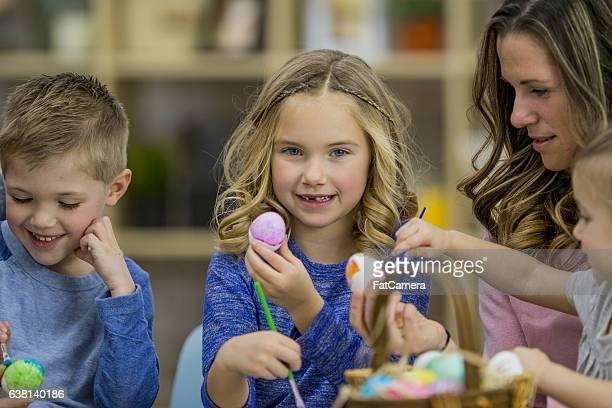 Siblings Painting Easter Eggs
