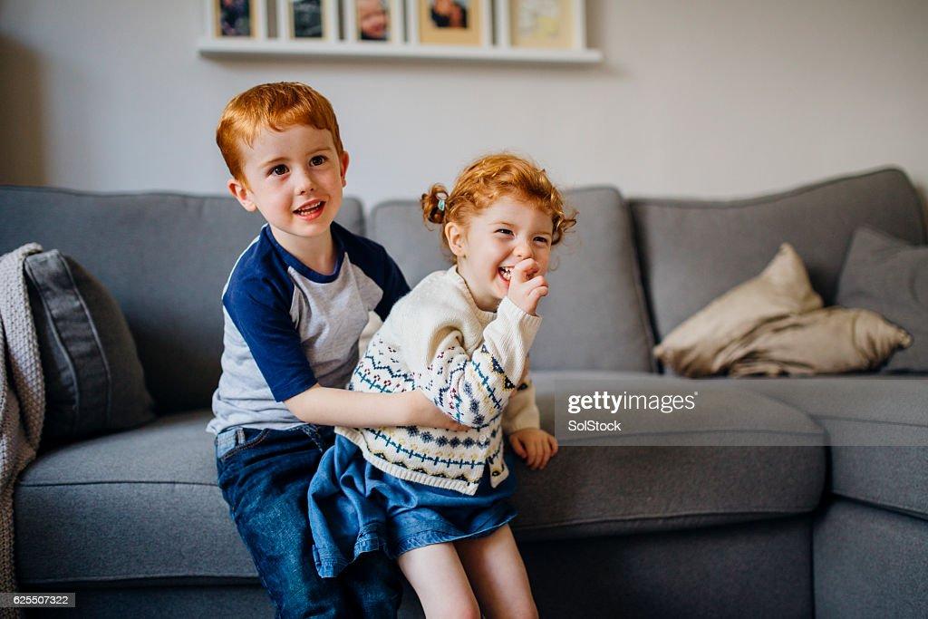 Siblings Playing at Home : Stock Photo