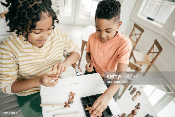 Siblings playing board games