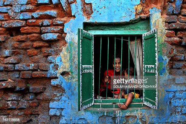 CONTENT] siblings playing in a decaying house at kolkata children in neighborhood what window in a depleted house where kolkata when during chhat...