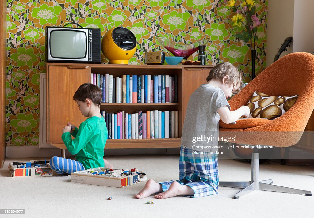 Siblings playing in living room : Stock Photo