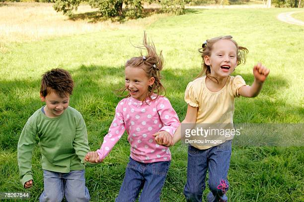 siblings playing in the park. - in the park day 3 imagens e fotografias de stock