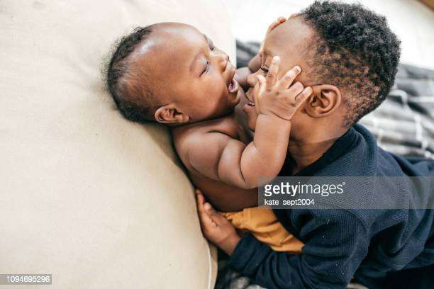 siblings playing together - sibling stock pictures, royalty-free photos & images