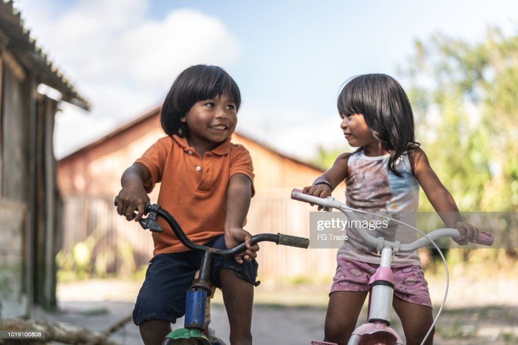 Siblings Riding a Bicycle in a Rural Place : Stock Photo