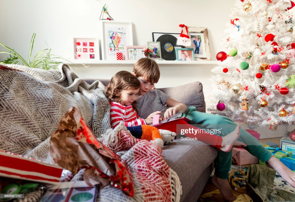 Siblings Sharing a Digital Tablet : Stock Photo
