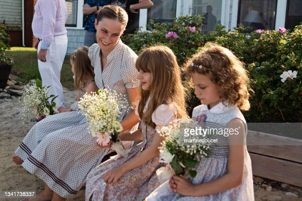 """siblings taking place outside beach house for small wedding. - """"martine doucet"""" or martinedoucet stock pictures, royalty-free photos & images"""
