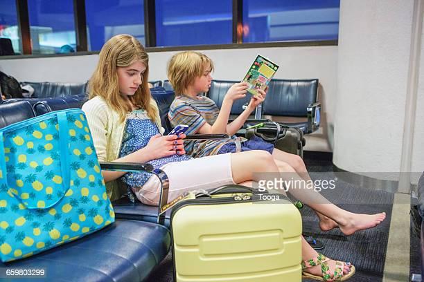 Siblings waiting for flight
