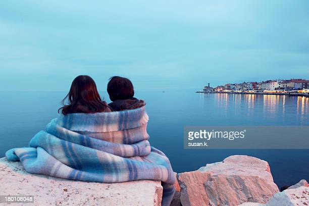Siblings watching beautiful night town scenery.