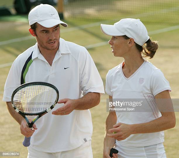Siblings Wayne Black and Cara Black of Zimbabwe in action during their Mixed Doubles quarter-final match against Nenad Zimonjic of Serbia and...