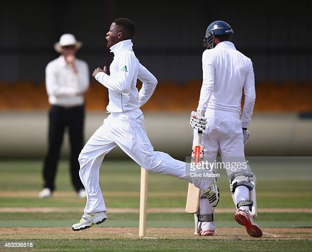Sibonelo Makhanya of South Africa celebrates dismissing Ed Barnard of England during day two of the second test match between England U19's and South...
