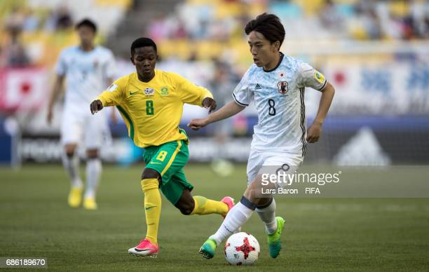 Sibongakonke Mbatha of South Africa challenges Koji Miyoshi of Japan during the FIFA U20 World Cup Korea Republic 2017 group D match between South...