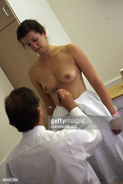 Sibongile Khumalo South African Doctor Rick marks the breast of a British patient before her plastic surgery in Johannesburg on October 23 2008...