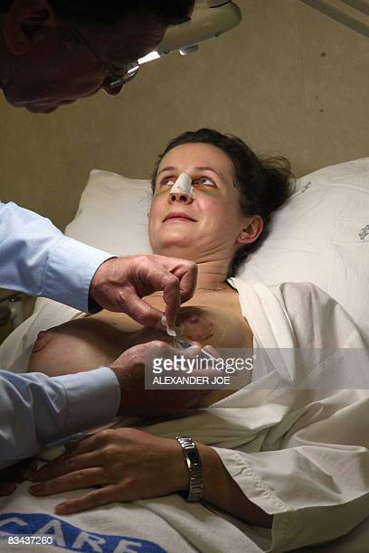 Sibongile Khumalo South African Doctor Rick removes the bandage on the breast of a British patient who had plastic surgery Johannesburg on October 26...