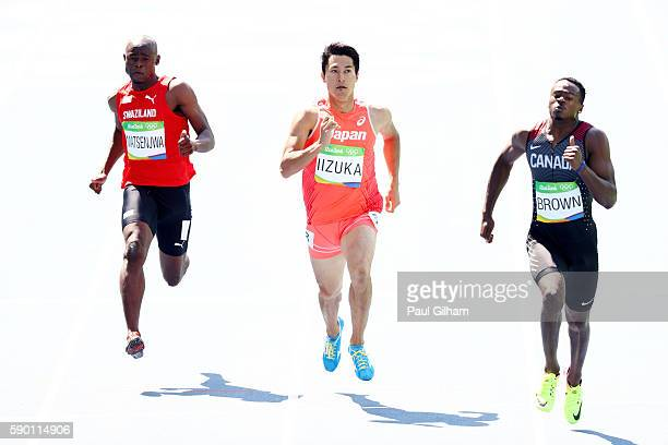 Sibusiso Matsenjwa of Swaziland Shota Iizuka of Japan and Aaron Brown of Canada compete during the Men's 200m Round 1 Heat 3 on Day 11 of the Rio...