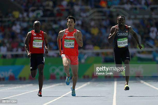 Sibusiso Matsenjwa of Swaziland Shota Iizuka of Japan and Aaron Brown of Canada compete during the Men's 200m Round 1 on Day 11 of the Rio 2016...