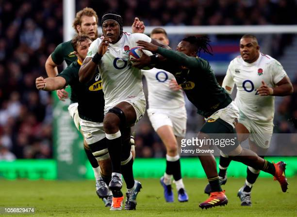 Sibusiso Nkosi and Duane Vermeulen of South Africa tackle Maro Itoje of England during the Quilter International match between England and South...